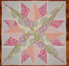 Mariners Compass quilt block (paper pieced)