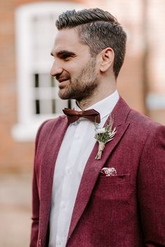 Groom in Red Wedding Suit and Bowtie | By Nicola Streader Photography | Stylish Wedding | Registry Office Wedding | Winter Wedding | Cool Wedding | Stylish Bride and Groom | Groom Outfit | Groom Suit | Wedding Suit | Coloured Wedding Suit