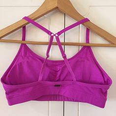 Fuchsia Lorna Jane Sports Bra Worn but in excellent condition. Size M. Come with pads. Option to wear straps normally or Racerback style. No Paypal. No trades. 10% discount on all bundles made with the bundle feature. No offers will be considered unless you use the make me an offer feature.     Please follow  Instagram: BossyJoc3y  Blog: www.bossyjocey.com Lorna Jane Tops Tank Tops