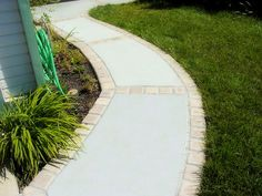 Broom Finish Walkway With Brick Borders by A. Townsend Concrete, via Flickr
