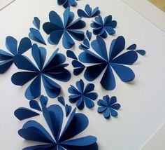 Cut out heart shapes & glue down only 1 side in a flower formation