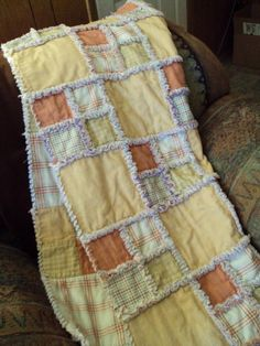 I like the idea of using different sized squares for rag quilts