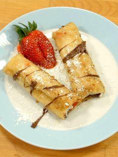 Das Beste am Morgen: French Toast Rolls mit Erdbeeren und Nutella. Ein zuckriges Äußeres und ein fruchtig-schokoladiges Inneres - das schnelle Rezept.