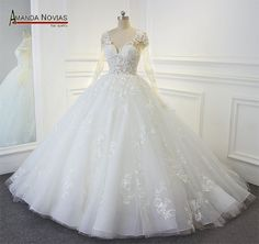 Item Type: Wedding Dresses Built-in Bra: Yes Actual Images: Yes Back Design: Lace Up Decoration: Beading,Appliques Silhouette: Ball Gown Brand Name: Amanda Novias Sleeve Style: Tank Sleeve Length: Ful