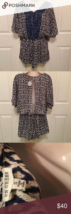 ⚜️NWT SHORTS ROMPER ONE PIECE OUTFIT⚜️Size Small This is the cutest romper! I bought it at a boutique in town but never wore & now it doesn't fit 😫. Size Small. Navy & Cream Tribal Aztec Print with Blue Paisley Accents 💙Draping open back with keyhole closure. V Neck Style. FYI; Keyhole closure seems a little loose (maybe from people trying on in the store, idk) but there is an extra button included! ⚜️ Bundle & Save More!💕🛍 En Creme Pants Jumpsuits & Rompers