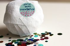 "<p>This clever interactive gift-wrapping idea from <a href=""http://speckled-egg.blogspot.com/2010/12/surprise-snowballs.html"">Speckled Egg</a> is a great way to make gifting money just a little more fun. Start wrapping white crepe paper into a ball and insert coins, bills, and other small surprises like candy or knickknacks along the way. This snowball is sure to delight and surprise. <i>(Photo: <a…"