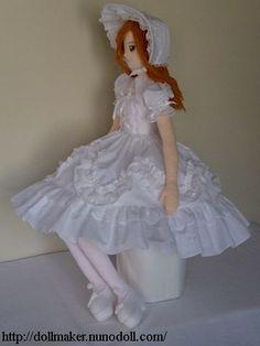 Girl doll in white dress