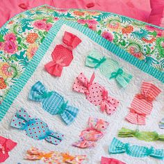 HOW SWEET IT IS: Dimensional Details Lap Quilt Pattern Designed by DEBORAH A. HOBBS 3-D quilt patterns are so much fun, and these dimensional Candy Blocks give tempting texture to this oh-so-sweet lap quilt. The How Sweet It Is lap quilt pattern includes step-by-step photos showing how to make the gathered candy wrappers - easy peasy! Pattern in The Best of McCall's Quilting - Summer 2016