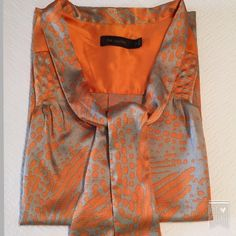 """Beautiful grey and orange cowl neck top. Great for the office or casual wear. Excellent condition. Worn once. 100% polyester. Measures 25"""" from shoulder to hem and 19"""" across the bust in front. The Limited Tops Blouses"""