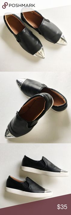 """Black and silver cap toe slip on sneakers I picked these up from a store in Tokyo but they're a tad small on me. The size is """"Medium"""" and would best fit a 6.5. I don't think they are real leather but they look very nice and add a bit of edge to any outfit. Only worn once! Shoes Sneakers"""