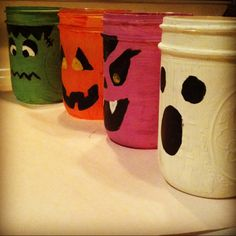 Painted Mason Jar Lanterns! Drop in a tea light and make em' glow. DIY Halloween Decor.