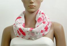 White infinity scarf with red rose floral print. Size/Dimensions Circular Loop - 60 inch width - 14.5 inch Scarf is stitched in a double layered tube form so no visible seams or unfinished raw fabric edges. Continuous loop allows you to stylize it in many different styles. A feminine, one of a kind scarf which will adorn your outfit. It is a versatile, stylish scarf and can be used as an accessory, neck wrap etc. This scarf is made of lightweight fabric and will accentuate any outfit.  P...