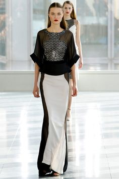 Antonio Berardi RTW Fall 2013. futuristic. black and white. sheer inserts. peplum. floor length skirt. racer back front. #fall2013 #london #AntonioBerardi