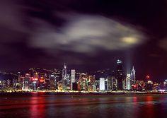 Hong-Kong Island skyline from the waterfront promenade by night. Hong-Kong, China