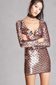 A knit bodycon dress featuring a sequined design, V-neckline with underwire at the V, long sleeves, and a high-polish zipper back. This is an independent brand and not a Forever 21 branded item.