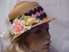Beige straw hat with a variety of flowers and by designer2 on Etsy, $20.00