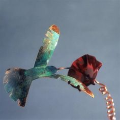 Copper Hummingbird on a Garden Stake by OutOfTheBoxGifts. $36.00. Handcrafted by Catherine Murphy. Patina copper hummingbird gracefully drinks from a brilliant red morning glory in full bloom. Handmade of shiny and patina copper with a UV clear coat for protection from the weather and to keep the finish lovely for years to come. Each piece is made by hand by artist Catherine Murphy and her team of artisans stamped with the mark of the Haw Creek Forge, in the mounta...