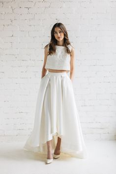 High - low Mikado skirt - Lily Ivory Mikado skirt featuring high-low hem cascades into a subtle train. Perfect for bride prefering to show Your shoes . Skirt is pretty heavy but very comfortable to wear !  - created and sewn in our studio ; - fixed waistband is 1 ( 2.5-3 cm) wide ; - hidden zipper at the back , additional hook and eye closure; - side pockets;  SIZE We will contact You within 2-3 works after order is placed with the list of required measurements .  PRODUCTION Current…