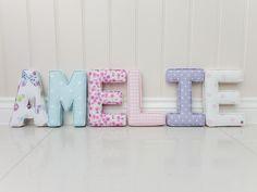 102 Amelie A - Butterfly Gardnes Lavender, M - Dotty Sky, E - Ditsy Rose heather, L - baby pink gingham, I - Nancy lavender, E - pink love hearts
