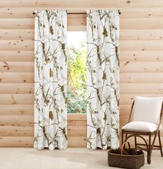 "Bring the outdoors inside with these beautiful 84"" length RealTree Snow camouflage pattern panel pair curtains. These camo curtains, offering life and personality, will make a great addition to any ro"