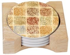 CounterArt Tuscan Tiles Design Absorbent Coasters in Wooden Holder, Set of 4 by Counter Art. $14.74. Holder is made of durable rubberwood with a clear varnish finish. Beautiful, colorful design meets high functionality with this coaster gift set. Coasters are natural stoneware with decorative transfer print. Set of 4 absorbent coasters in wooden display holder. To remove coaster stains, soak coaster in 1 part household bleach and 3 parts water until stain lifts, then rinse and a...