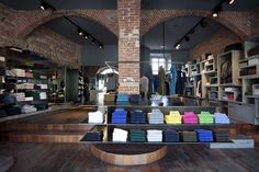 Love the set up of this Sun68 flagship store & showroom by C Architetti, Milan. Esp that wall display on the right