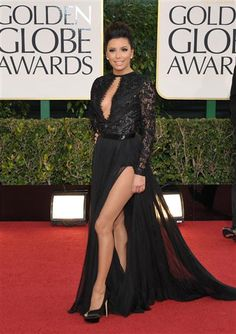 Eva Longoria at the Golden Globes.  She had a nip slip in that dress later, but I still love it.  Lace sleeves, cut out, and high slit.