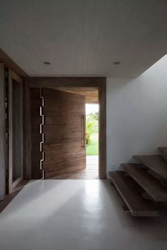 Pivot door at BEACH SIDE HOME IN BRAZIL renovated by Vida de Vila architects