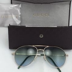 Authentic Gucci Aviator Sunglasses! Gorgeous aviator sunglasses with a Green tint.  In excellent condition.  Comes with everything in picture. Gucci Accessories Sunglasses