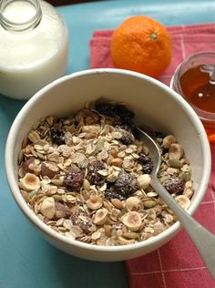 Hazelnut Cherry Muesli - 1/2 cup whole hazelnuts, 1/4 pumpkin seeds, 3/4 cups rye flakes, 1/2 cup old-fashioned rolled oats, 1/4 cup wheat bran, 1/2 cup dried cherries, 1/4 t cinnamon, honey, milk (or yogurt)