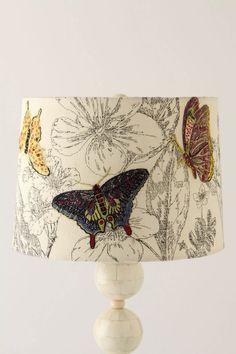 goes with butterfly shower curtain from West Elm, would be cute on a little side table in the bathroom