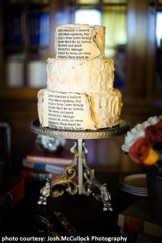 A wedding #cake with book page adornments filled with love...now that's a unique centerpiece for your #library theme #wedding!  Library Wedding Cake by http://www.mishellehandycakes.com/  Photo Credit: Josh McCullock Photography  http://joshmccullock.com