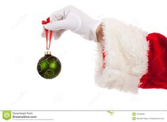 Santa Claus hand holding a sparkly red ornament on a gold ribbon over a light to dark red background. Description from dreamstime.com. I searched for this on bing.com/images