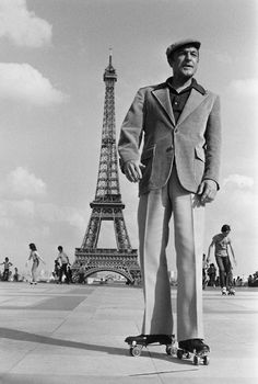 "Gene Kelly roller skating in Paris. ""I got started dancing because I knew it was one way to meet girls."""