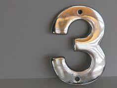 Vintage number three sign