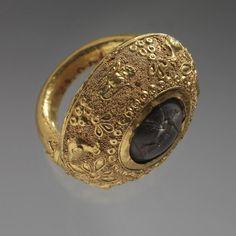 "theancientwayoflife:  ""~ Ring.  Culture: Etruscan  Dare: 4th century B.C. - 3rd century B.C.  Medium: Gold, milk-grey stone  """