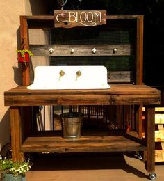 This potting bench we created featured a reclaimed cast-iron farm sink that had spent the past 40 years in a barn. This too was created with all reclaimed lumber.