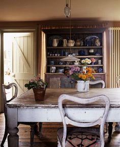Vintage Dining, love the bookcase storage!