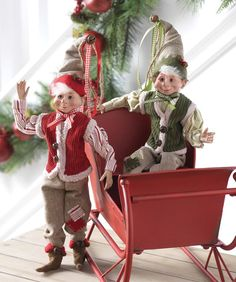"""RAZ Farmhouse Elves Set of 2  2 Assorted elves Set includes one of each style Made of Polyester Measures 16"""" Decorated in red, green tan clothing For Decorative Use Only Not Intended for Children RAZ Exclusive Design  RAZ 2016 Farmhouse Collection"""