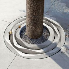A very beautiful tree grate with a great design reminding the waves that wind creates on sand. Landscape And Urbanism, Landscape Elements, Contemporary Landscape, Landscape Design, Urban Furniture, Street Furniture, Tree Grate, Paving Pattern, Urban Ideas