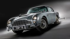 """A US car enthusiast has bought James Bond's famous Aston Martin car at auction for more than four million dollars. The 1964 silver Aston Martin was driven by Sean Connery in the films """"Goldfinger"""" and """"Thunderball"""" Aston Martin Db5, James Bond Cars, James Bond Movies, Alfa Romeo Spider, Maserati Ghibli, General Lee, Lamborghini Miura, Datsun 240z, 4 Lug Rims"""