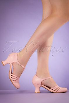 Party or a day at the office? With these 50s Lucy T-Strap Pumpsyou'll always look fantastic!  The perfect pumps, right?! A cute and comfy heel, super elegant, ultra versatile and all of that with a vintage touch ;-)Made from light pink 'faux' leather with cute straps and a t-strap that's finished off with elastic ensuring a perfect fit without pinching.Bettie Page knows what women want, elegance with comfort...Versatile vintage...