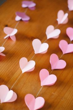 This DIY heart garland would be a great decoration for a bridal shower!