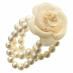 wouldn't mind white pearls for a wrist corsage if it weren't too expensive but it probably would be...