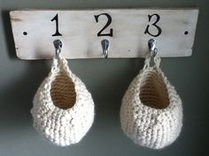Chunky Crocheted Baskets - Free Pattern by the crochet diaries     Hang these on hooks or door knobs to keep scarves, mitts, keys, etc!