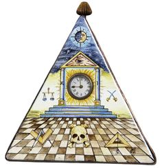 This hand-painted enameled clock, done in the Limoges style, depicts the symbolism of early Blue Lodge Masonry.