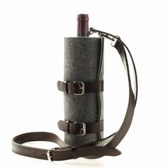 Felt and leather wine bottle carrier. I think this is so pretty! I want to make one to fit a thermos.