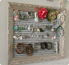 jewelry organizer  1. Can of spray paint to update frame 2. Dollar tree $1 dish towel for fabric backing  3. $3 Walmart corsage pins for hooks.   4. PRICELESS!!!