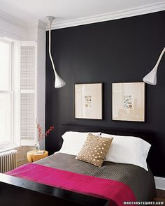 "An intense black wall, offset by some natural touches, gives this room an easy, but artful, elegance. ""I like mixing antique and modern because things stand out more when styles are contrasted,"" says Suzanna, the room's occupant."