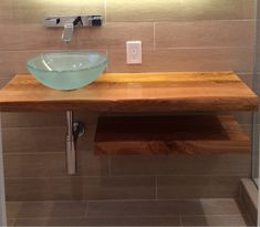 Ash wood natural edge bathroom counter top and shelf. Epoxy details and varnish oil blend finish.